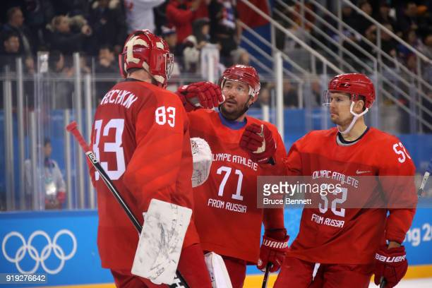 Vasili Koshechkin Ilya Kovalchuk and Sergei Shirokov of Olympic Athlete from Russia celebrate after defeating the United States 40 during the Men's...