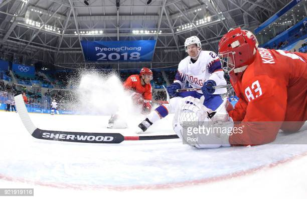 Vasili Koshechkin of Olympic Athlete from Russia makes a save against Steffen Thoresen of Norway during the Men's Playoffs Quarterfinals on day...