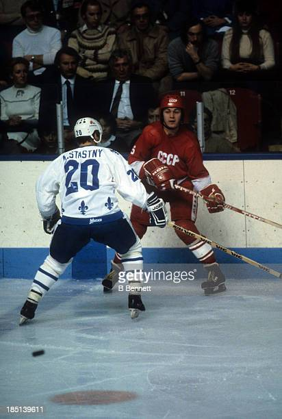 Vasili Pervukhin of the USSR passes the puck before being checked by Anton Stastny of the Quebec Nordiques during the 198283 Super Series on December...