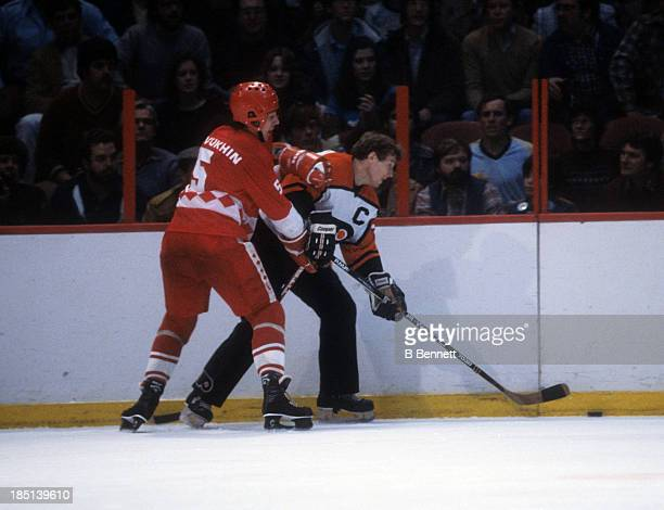Vasili Pervukhin of the USSR tries to check Bobby Clarke of the Philadelphia Flyers during the 198283 Super Series on January 6 1983 at the Spectrum...