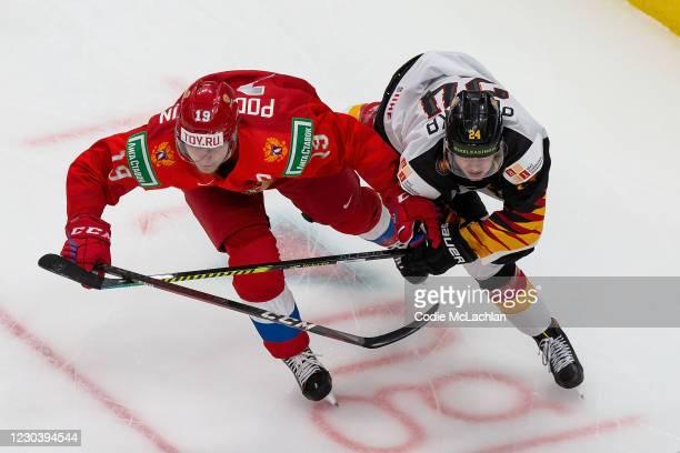 Vasili Podkolzin of Russia skates against John Peterka of Germany during the 2021 IIHF World Junior Championship quarterfinals at Rogers Place on...