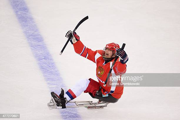 Vasilii Varlakov of Russia celebrates after scoring the first goal during the Ice Sledge Hockey Preliminary Round Group A match between the Russia...