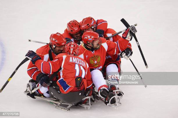 Vasilii Varlakov of Russia celebrates with team mates after scoring the first goal during the Ice Sledge Hockey Preliminary Round Group A match...