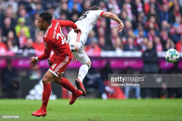 Vasilije Janjicic of Hamburg and Tolisso of Bayern Muenchen fight for the ball during the Bundesliga match between FC Bayern Muenchen and Hamburger...