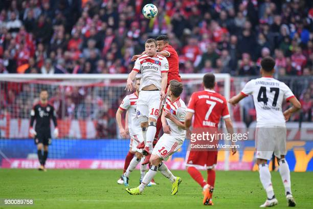 Vasilije Janjicic of Hamburg fights for the ball with Tolisso of Bayern Muenchen during the Bundesliga match between FC Bayern Muenchen and Hamburger...