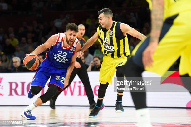 Vasilije Micic #22 of Anadolu Efes Istanbul competes with Kostas Sloukas #16 of Fenerbahce Beko Istanbul during 2019 Turkish Airlines EuroLeague...