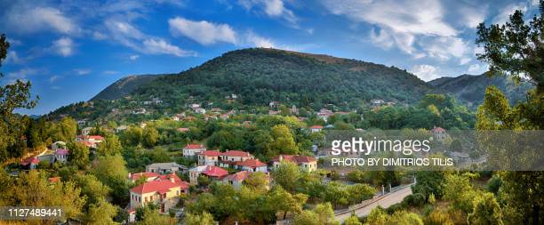 vasiliko stonebuilt village panorama - epirus greece stock pictures, royalty-free photos & images