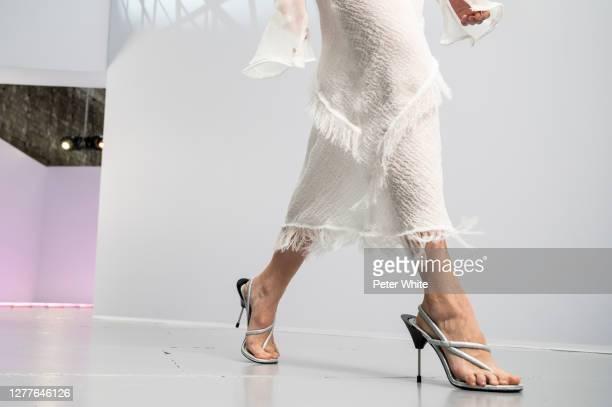 Vasilina Kireenko, shoe detail, walks the runway during the Acne Studios Womenswear Spring/Summer 2021 show as part of Paris Fashion Week on...