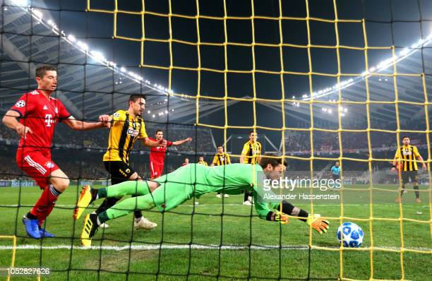 Vasilios Barkas of AEK Athens saves the ball on the goal line during the Group E match of the UEFA Champions League between AEK Athens and FC Bayern...