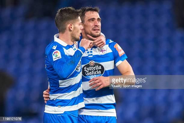 Vasilios Lampropoulos of Deportivo de La Coruna cries with emotion next to Francisco Montero at the end of the La Liga Smartbank match between...