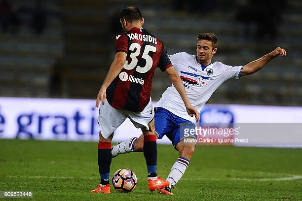Vasilis Torosidis of Bologna FC competes the ball with Karol Linetty of UC Sampdoria during the Serie A match between Bologna FC and UC Sampdoria at...
