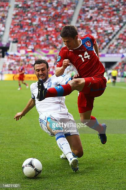 Vasilis Torosidis of Greece puts in the tackle on Vaclav Pilar of Czech Republic during the UEFA EURO 2012 group A match between Greece and Czech...
