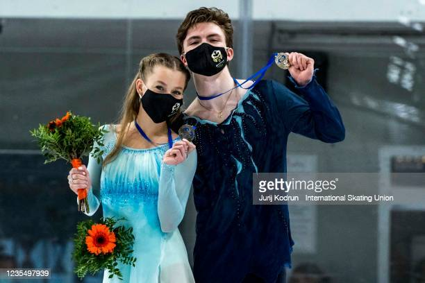 Vasilisa Kaganovskaia and Valeriy Angelopol of Russia pose with the gold medal during medal ceremony after the ISU Junior Grand Prix of Figure...