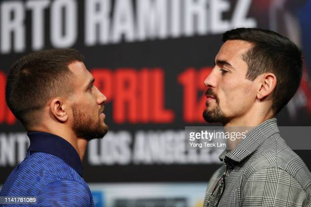 Vasiliy Lomachenko and Anthony Crolla face off after the press conference ahead of their world lightweight championship fight at Staples Center on...