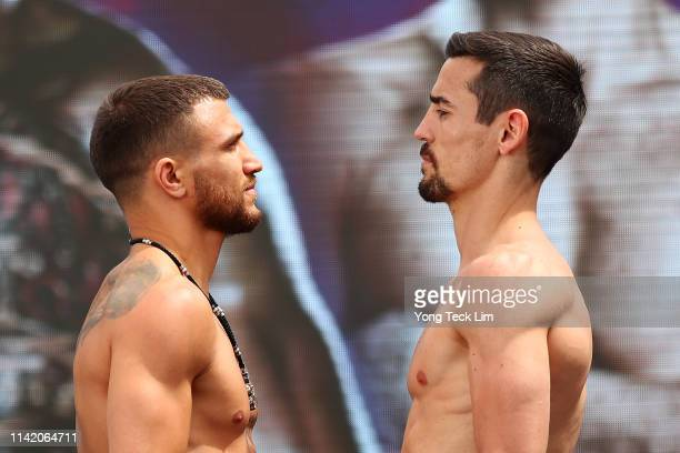 Vasiliy Lomachenko and Anthony Crolla face off during their official weighin ahead of their unified lightweight title fight at Los Angeles Convention...