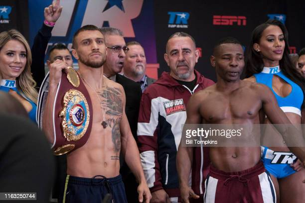 December 8: Vasiliy Lomachenko and Guillermo Rigondeaux weigh in and pose during the weigh in at Madison Square Garden on December 8, 2017 in New...