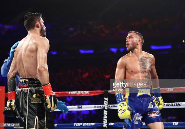 Vasiliy Lomachenko and Jorge Linares exchange words during their WBA lightweight title fight at Madison Square Garden on May 12 2018 in New York City