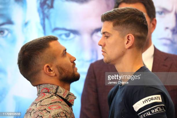 Vasiliy Lomachenko and Luke Campbell face off after speaking to the media during the Vasiliy Lomachenko and Luke Campbell press conference in the...