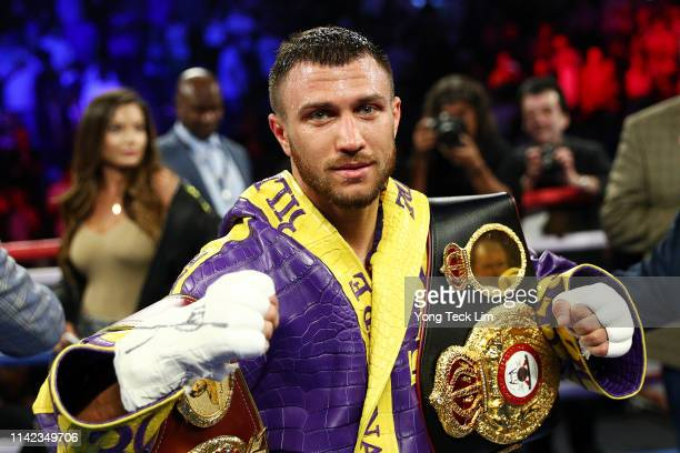 Vasiliy Lomachenko celebrates defending his WBA/WBO lightweight titles after knocking out Anthony Crolla at Staples Center on April 12, 2019 in Los...