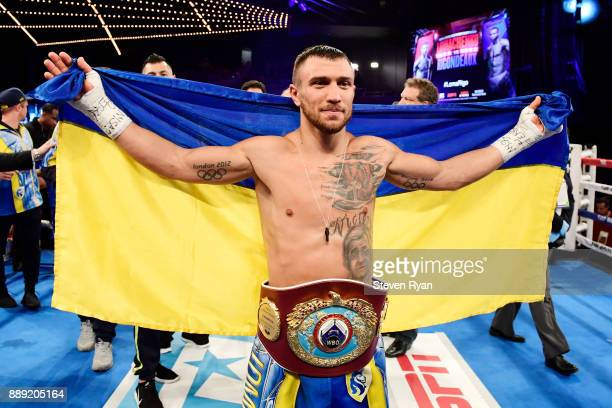 Vasiliy Lomachenko celebrates his Junior Lightweight bout victory over Guillermo Rigondeaux at Madison Square Garden on December 9 2017 in New York...