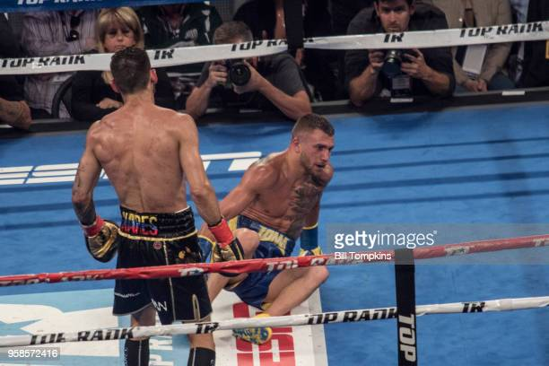 Vasiliy Lomachenko goes down in his bout with Jorge Linares by technical knockout in the 10th Round at Madison Square Garden NYC on May 12 2018 in...
