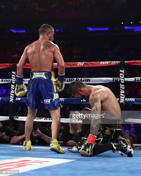 Vasiliy Lomachenko knocks down Jorge Linares in the tenth round during their WBA lightweight title fight at Madison Square Garden on May 12 2018 in...