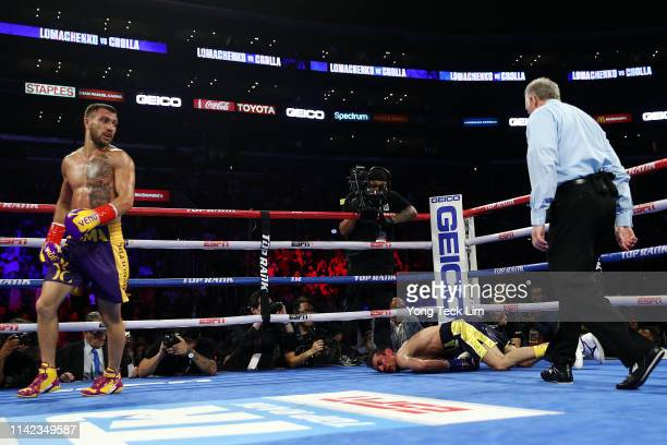 Vasiliy Lomachenko knocks out Anthony Crolla during their WBA/WBO lightweight title bout at Staples Center on April 12 2019 in Los Angeles California