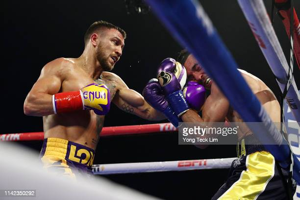 Vasiliy Lomachenko punches Anthony Crolla during their WBA/WBO lightweight title bout at Staples Center on April 12 2019 in Los Angeles California