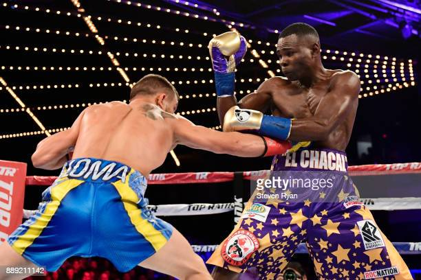 Vasiliy Lomachenko punches Guillermo Rigondeaux during their Junior Lightweight bout at Madison Square Garden on December 9 2017 in New York City