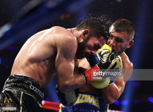 Vasiliy Lomachenko punches Jorge Linares during their WBA lightweight title fight at Madison Square Garden on May 12 2018 in New York City