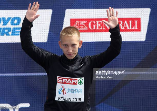 Vasiliy Mizinov of Authorised Neutral Athletes bronze poses during the medal ceremony for the Men's 20km Race Walk during day five of the 24th...