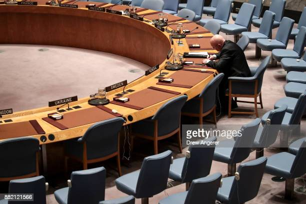 Vasilly Nebenzia Russian ambassador to the United Nations writes notes at his seat prior to the start of an emergency meeting of the United Nations...