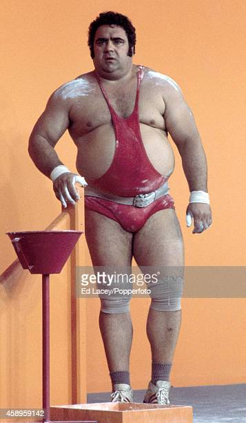 Vasily Alekseyev of the Soviet Union en route to winning the gold medal and setting a World Record in the super heavyweight weighlifting class during...