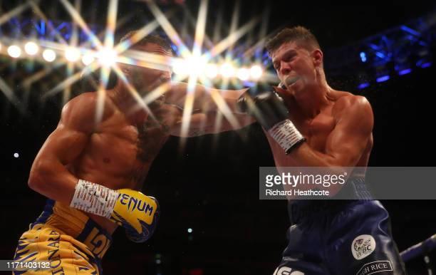 Vasily Lomachenko and Luke Campbell are pictured during the WBA, WBO, WBC Lightweight World Title contest between Vasily Lomachenko and Luke Campbell...