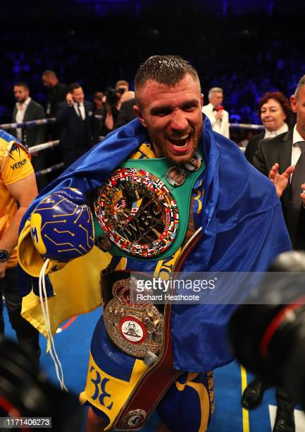 Vasily Lomachenko celebrates after winning the WBA, WBO, WBC Lightweight World Title contest between Vasily Lomachenko and Luke Campbell at The O2...
