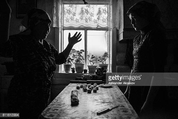 REGION SIBERIA RUSSIA OCTOBER 3 2015 Vasima and her niece Lena cook traditional Tatar donuts baursaki to celebrate Kurban Bayram in the village of...