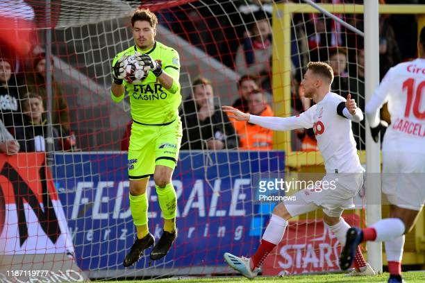 Vaso Vasic goalkeeper of Mouscron is challenged by Renaud Emond forward of Standard Liege during the Jupiler Pro League match between Royal Excel...