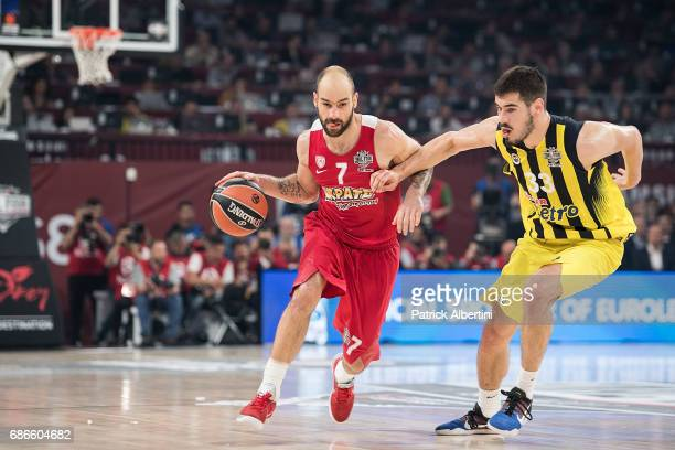 Vassilis Spanoulis #7 of Olympiacos Piraeus competes with Nikola KalinicÊ#33 of Fenerbahce Istanbul in action during the Championship Game 2017...