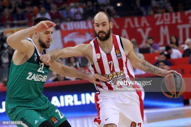 Vassilis Spanoulis #7 of Olympiacos Piraeus competes with Vasilije Micic #22 of Zalgiris Kaunas during the Turkish Airlines Euroleague Play Offs Game...
