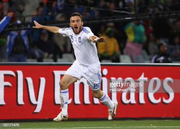 Vassilis Torosidis of Greece celebrates after he scores his team's second goal during the 2010 FIFA World Cup South Africa Group B match between...