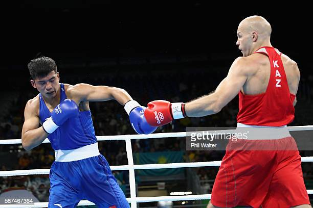 Vassiliy Levit of Kazakhstan fights against Fengkai Yu of China blue in their Mens 91kg Heavyweight bout on Day 3 of the Rio 2016 Olympic Games at...