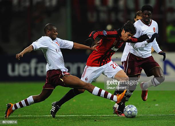 Vassiriki Diaby and Emmanuel Adebayor of Arsenal challenge Kaka of AC Milan during the UEFA Champions League 1st knockout round 2nd leg match between...
