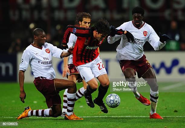 Vassiriki Diaby, Mathieu Flamini and Emmanuel Adebayor of Arsenal challenge Kaka of AC Milan during the UEFA Champions League 1st knockout round 2nd...