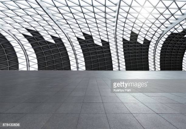 Vast empty Futuristic Architecture with gray floors and silver Metal line wall, Auto advertising background