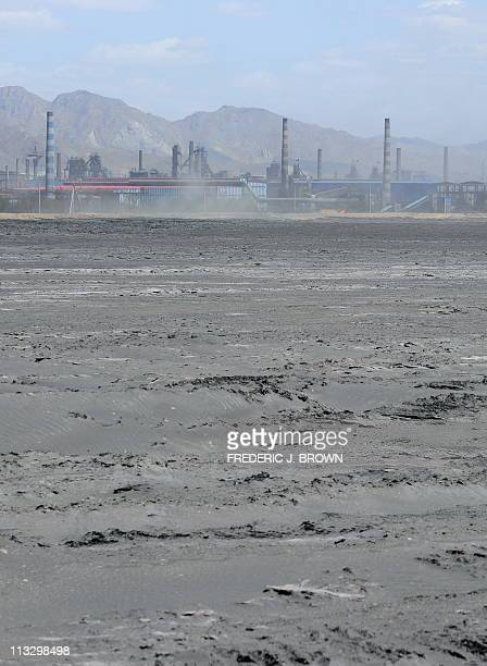 Vast expanse of toxic waste fills the tailings dam on April 21 frequently whipped up by strong winds dumping mllions of tonnes of radioactive...