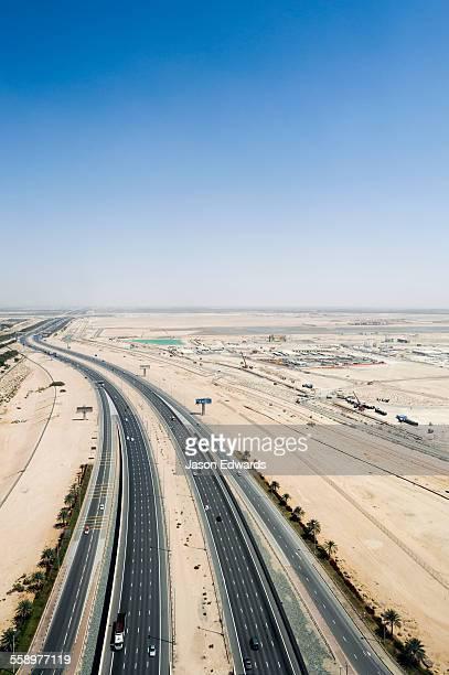 A vast multi-lane highway dissecting the desert.