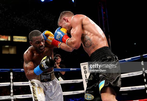 Vasyl Lomachenko and Gary Russell Jr exchange punches in their WBO Featherwieight Title bout at StubHub Center on June 21 2014 in Los Angeles...