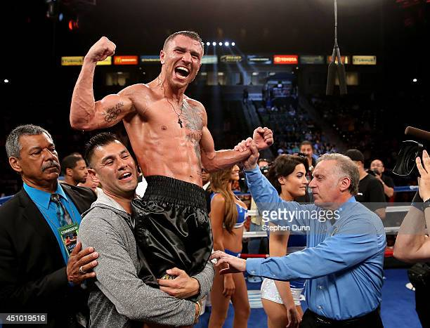 Vasyl Lomachenko celebrates after hearing the decision against Gary Russell Jr in their WBO Featherwieight Title bout at StubHub Center on June 21...