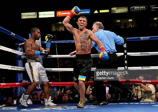 Vasyl Lomachenko celebrates after the final bell against Gary Russell Jr in their WBO Featherwieight Title bout at StubHub Center on June 21 2014 in...