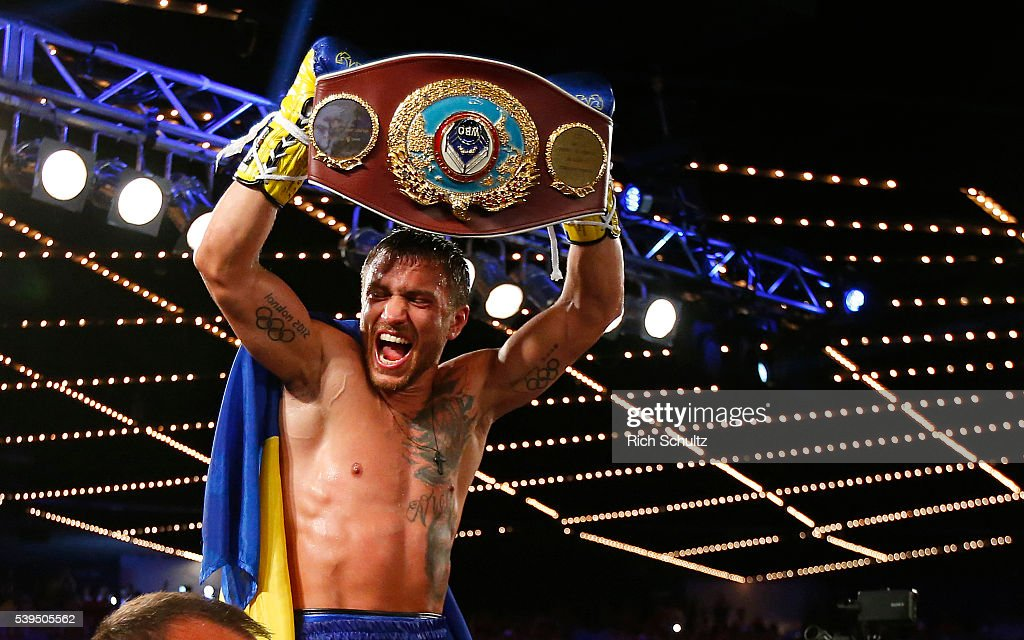 Vasyl Lomachenko holds the championship belt after defeating Roman Martinez by knock out during the fifth round of their Junior Lightweight WBO World Championship bout on June 11, 2016 at the Theater at Madison Square Garden in New York City.
